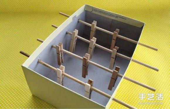 鞋盒废物利用做桌上足球玩具的方法教程 -  www.shouyihuo.com